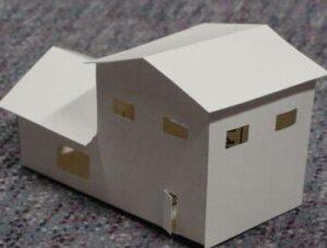 Модель здания с бумагой